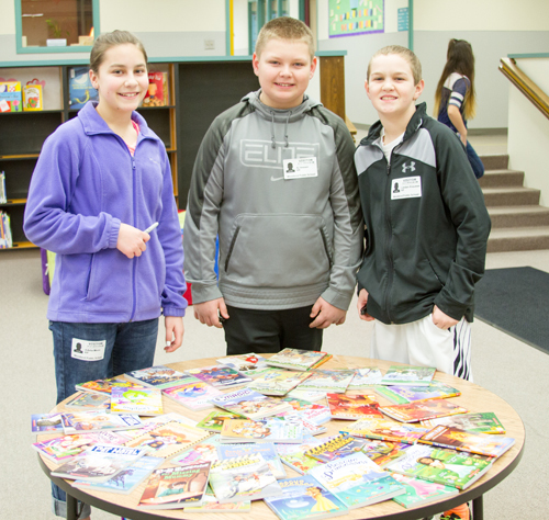 Woodland elementary students receive free books to motivate and