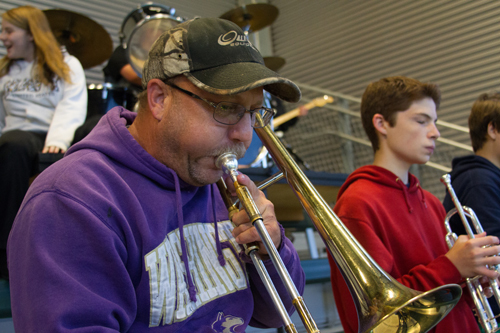 Jim Bair volunteered to play trombone at Woodland's football games after his daughter convinced him to participate last year.