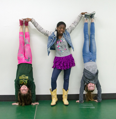 "Alexis Caughell (sixth grade), Grace Reister (fifth grade) and Lily Wear (fifth grade) joined ""Girl Talk and Tennies"" to make friends and be active."