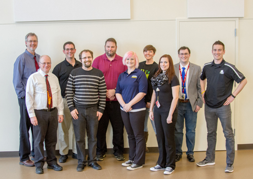 The ten schools' band directors (pictured here) select pieces at the beginning of each year to practice for the months leading up to the Mass Band Concert.