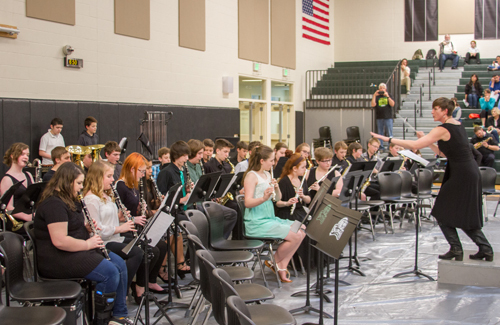 Bryana Steck served as this year's concert organizer, and directed one of the ensemble pieces along with the Woodland Middle School's Trojan Band's individual performance.