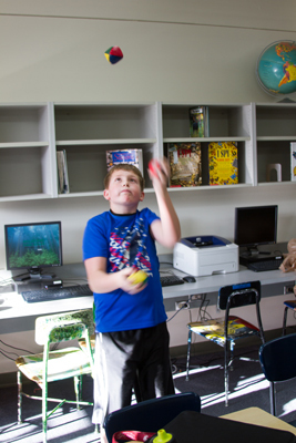 Drew Burns, sixth grader, enjoys showing his friends and family the juggling skills he learned from his lunchtime club.