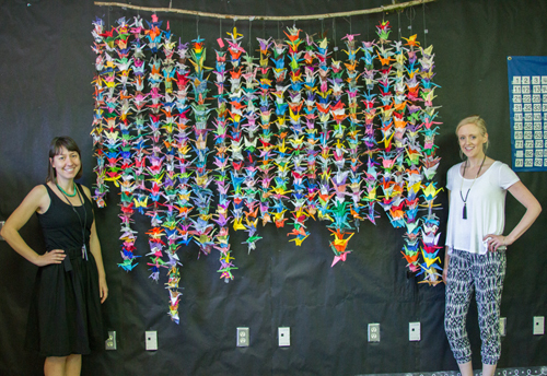 Carlotta Prospersi, ELL Teacher, and Megan Lascik, Third Grade Teacher, show the finished 1,000 paper cranes hanging from a special display mount.