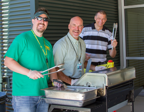 The Employee of Excellence Awards are held at a special year-end BBQ luncheon hosted by district administrators (pictured: Jake Hall, WMS Principal; John Shoup, WHS Principal; and Dan Uhlenkott, WHS Assistant Principal and TEAM High Principal)