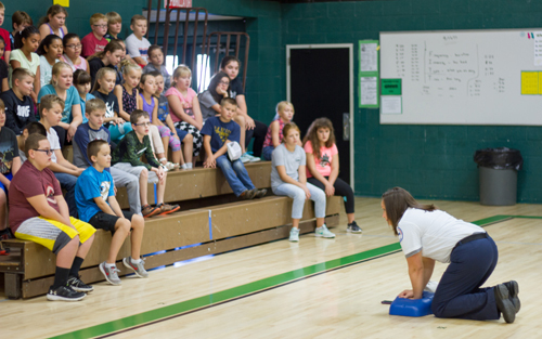Kanessa Thompson, a paramedic and Communications Coordinator for Clark County EMS, teaches students how to perform CPR
