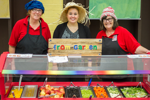 Laura Perry (center) works with Woodland Primary School's chefs Cris Forgey (left) and Judi Lute (right) to introduce a new fruit and vegetable each week using the letters of the alphabet