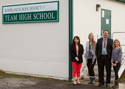 Stacy Brown (Business Services Manager), Jillian Jacobs (TEAM High Teacher), Jake Hall (Exec. Director of Learning Supports and Alternatives) and Stacie Crochet (local mental health provider) stand outside TEAM High School where students can now access free mental health services.