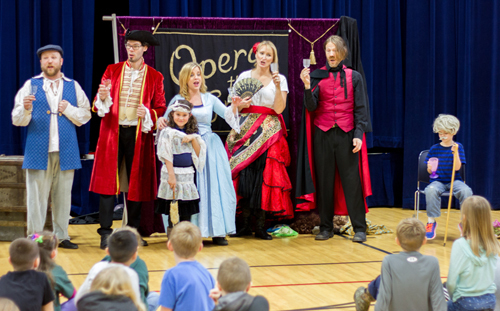 "Professional opera singers brought students on-stage to participate in ""Opera the Great!"" Pictured: Alexia Baker and Jack White, both first graders."