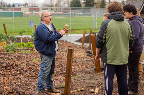 Joe Bosch directs students in the project to expand the school's community garden to 6,200 square feet.
