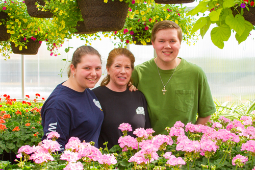 Mary Ellen Vetter (center) won Outstanding Southwest Washington Teacher of the Year and Cooper Kaml (right) won the State Championships as a rookie, this being his first time taking the class and growing plants ever.